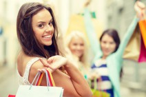sale, shopping, tourism and happy people concept - beautiful woman with shopping bags in the ctiy; Shutterstock ID 190353911; PO: today.com